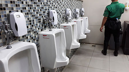 A line of waterless urinals in a restroom in Jakarta