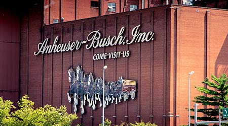 Saint Louis, MO—Aug 4, 2018; sign on brick wall marks the Anheuser Busch brewery. The facility produces beer brands such as Budweiser and is home to the iconic Clydesdale horse team.