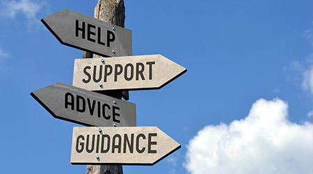 """Wooden signpost with four arrows - """"help, support, advice, guidance"""". Great for topics like customer support, assistance, business presentations etc."""