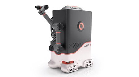 A restroom cleaning robot that looks like  a minifridge with an arm attached to its front