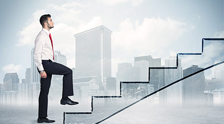 man in suit and tie walking up stairs to symbolize moving up in his career