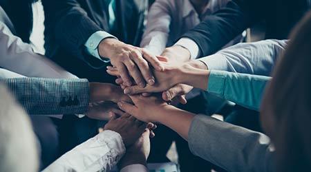 A closeup of a group huddle