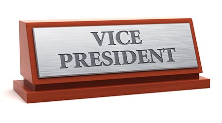 a desk plaque reading 'vice president'