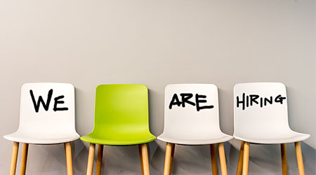 "Chairs reading ""we are hiring"""