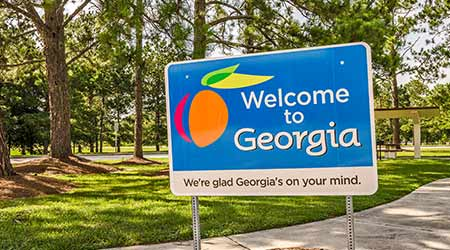 "A sign welcoming people to the state of Georgia with reference to ""Georgia's On My Mind"""