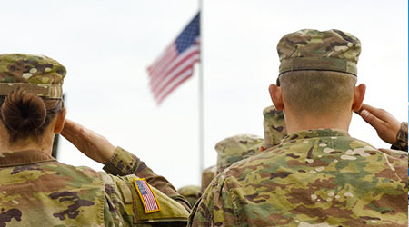 soldiers saluting the American flag