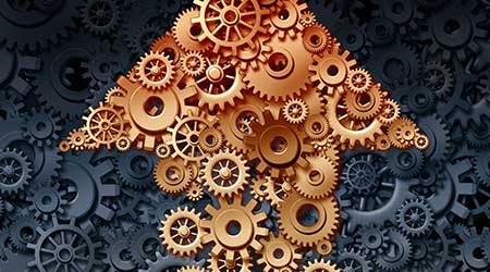 Growing industry with a group of gears and cogs coming together to form the shape of an upward arrow