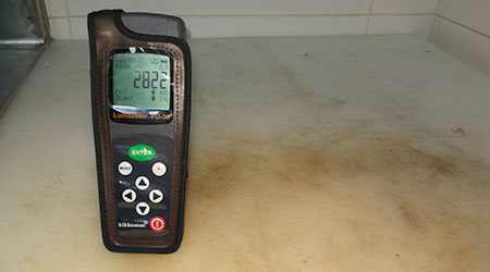 Malaysia. April 1 2018. An ATP meter with reading of the dirty white chopping board. it is use to test for the presence of adenosine triphosphate (ATP) to verify cleaning effectiveness.