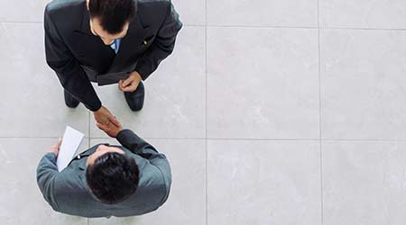 bird's eye view of business partners shaking hands