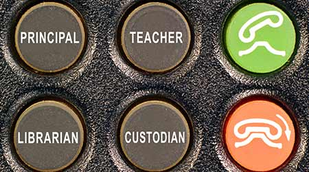 Concept of old phone keypad buttons for calling school staff