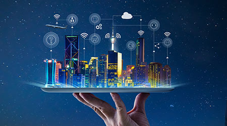 Waiter hand holding an empty digital tablet with Smart city with smart services and icons, internet of things, networks and augmented reality concept , night scene .