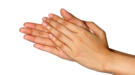 Cropped view of a women set of hands with palms rubbing together