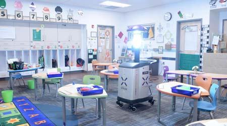 A germ-killing robot in an elementary school classroom