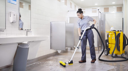 female janitor cleaning restroom