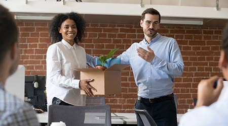 Friendly company ceo welcoming female employee. introducing hired worker in multiracial office. getting acquainted supporting new team member on first work day.