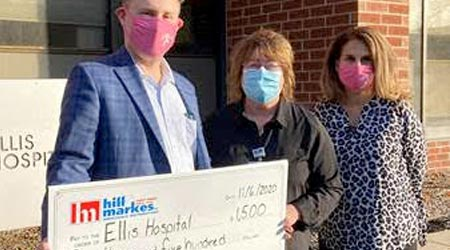 a big check being awarded to a hospital as charity