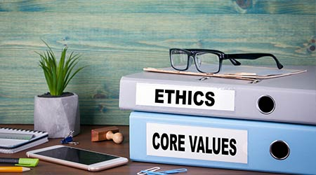 two binders, one regarding business ethics and another regarding core values