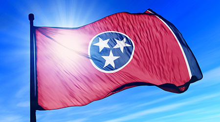 Tennessee's state flag blowing in the breeze on a sunny day