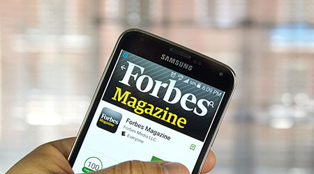 MONTREAL, CANADA - MARCH 20, 2016 - Forbes Magazine application on Samsung S5's screen. Forbes is an American business magazine, published bi-weekly.