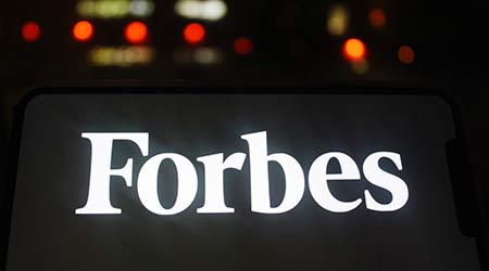 Moscow, Russia - 20 May 2020: Forbes logo on a Mobile phone screen. Forbes is an American business magazine.