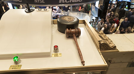 NEW YORK, NY - FEBRUARY 14, 2014: View of the hammer to ring opening bell of New York Stock Exchange on the NYSE balcony