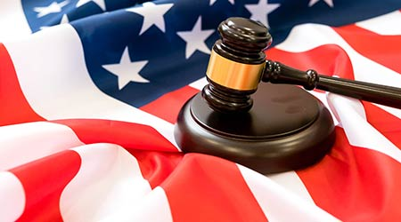 wooden gavel on the American flag