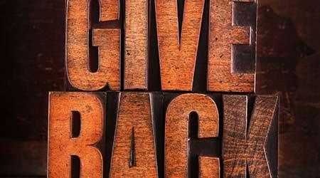 "Very Old Vintage Letterpress spelling out ""Give Back"""
