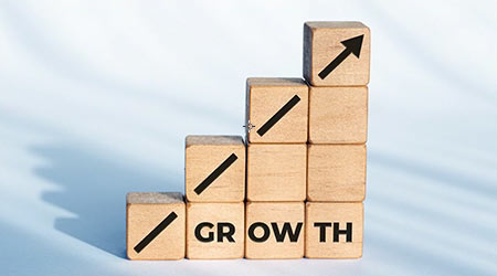 Growth or business concept. Arrow icon and word on wooden dices