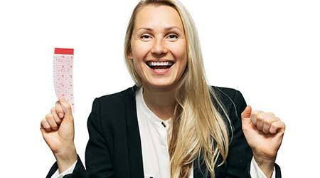 woman holding a winning lottery ticket