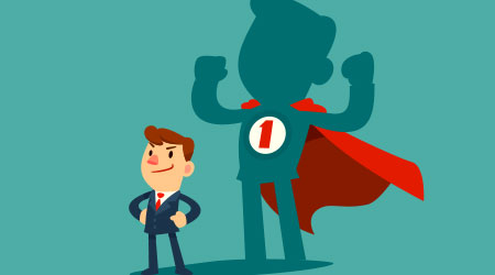 Confident businessman standing in front of his shadow wearing red cape as a superhero. Business ambition concept.