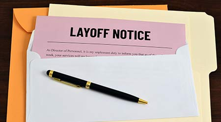 An illustrative image to show a letter sent to employees or workers of layoff notice. Business concept image for unemployment.