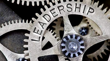 """tooth wheel mechanism with """"leadership"""" written on it"""