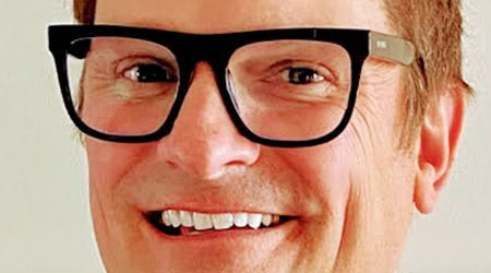 red-haired man in glasses