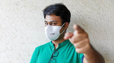 Middle-aged adult man wearing an N95 mask