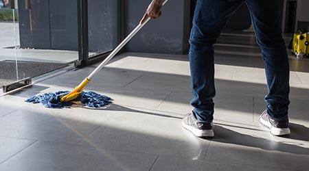 A man mopping an office