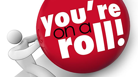 You're On a Roll ball pushed up hill succeeding winning streak consistent momentum