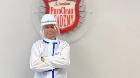 a worker in a protective suite. PPE.
