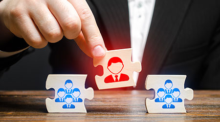 A businessman appoints a leader to the head of the team. Creation of an effective teams of specialists for the implementation of a new project.