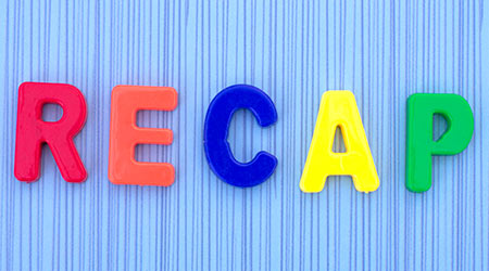 RECAP word made up of plastic letters on a blue background. Business concept.