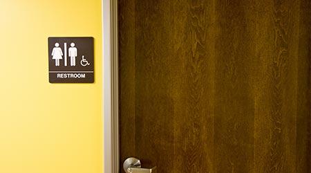 Restroom with signage/Restroom door and sign/Detail of restroom