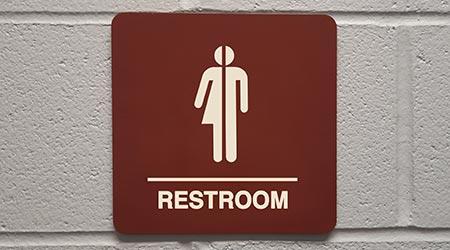 """Gender Neutral bathroom sign that says, """"RESTROOM"""""""