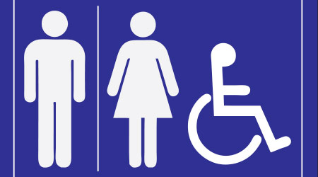 blue sign to refer to a public toilet. The label with the designation of men, women and those with disabilities