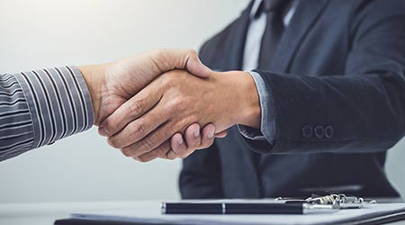 Handshake of cooperation customer and salesman after agreement