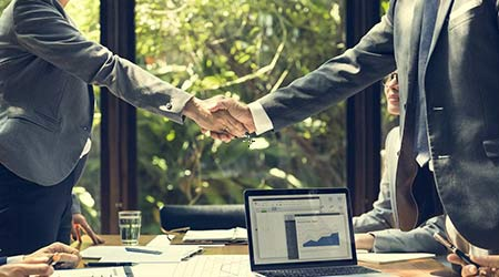 man and woman shaking hands to demonstrate business partnership. business partnership concept.