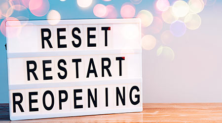 Words reset, restart and reopening on the light box. New life, new business, new deals concept.