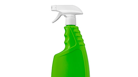 Green plastic bottle with cap isolated on white background for liquid spray detergent laundry or cleaning agent