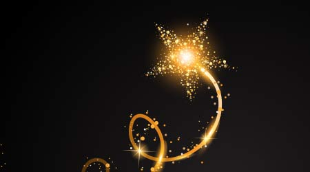 a start with a gold, glittering spiral of dust