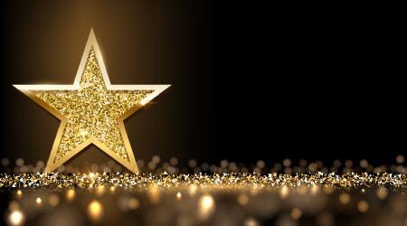 Golden sparkling star isolated on dark luxury horizontal background. Vector design element