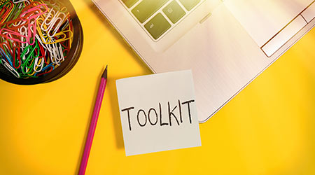 Handwriting text writing Toolkit. Concept meaning set of tools kept in a bag or box and used for a particular purpose Metallic laptop sticky note clips container pencil colored background.
