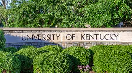 LLEXINGTON, KY/USA - JUNE 3, 2018: Entrance sign and foliage background to the campus of the University of Kentucky.